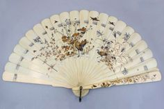 A Japanese shibayama lacquered ivory fan, late Meiji period ~ The Shibayama technique (usually associated with lacquer, 芝山漆器) was named after craftsman Shibayama Senzo (大野木専蔵, born Ōnoki Senzō from Shibayama village, Shimo-osa, now Chiba prefecture, 18th century) who is said to have perfected the art of applying mother of pearl inlay to ivory. Shibayama ware was used exclusively for items to be exported to the West.