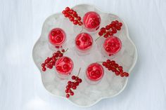 Redcurrant sorbet is really easy to make as it doesn't even involve any cooking. Our recipe uses some orange liqueur to give it extra depth of flavour and to prevent it from becoming too hard. It can be served as a refreshing dessert of a hot summer's day, but it is also superb served in shot glasses in a tray of ice as part of a party buffet.