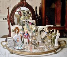 "From Mary Ellen Magnotto Druckenmiller: A few of my collections/passions. Vintage costume jewelry, vintage mini perfume bottles, old bride & groom cake toppers, 1940's Barclay lead train figures, vintage Coro duette pins - and the list goes on!"" Dusty Old Thing.com"