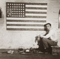 Jasper Johns in his studio on Pearl Street with Flag, 1954-55, New York.