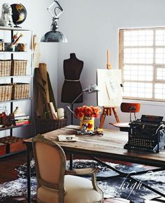 dress form in white office with wooden table and shelving, industrial nautical looking pendant light