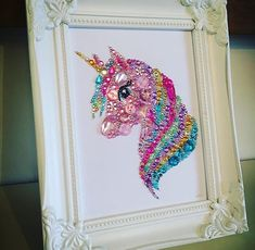 Unicorn decoration, unicorn button Swarovski crystal framed art picture. Button frame. Unicorn gift. Personalised gift. Our unicorn is created using high quality embellishments and genuine Swarovski crystals. Each piece is handmade with love to a high standard. Available in two