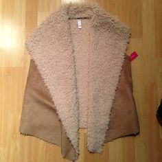 FINAL PRICE vest MWT Medium/large size soft furry vest with suede like outside. Perfect with a chambray top. 100% polyester. Great for upcoming fall weather! Xhilaration Jackets & Coats Vests