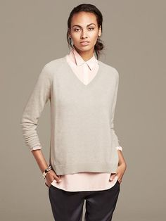 "home | Banana Republic fabric & care     40% Viscose, 35% Nylon, 25% Merino Wool.     Hand wash. Imported.     Our pullover features a sweater-knit front and draped woven back.     V-neck. Long sleeves.     Split hem. Ribbed trim. fit & sizing     Hits at the hip in front. Hits at the low hip in back. shipping & returns     FREE shipping on all orders over $50     Select the ""FREE"" option in the shopping bag     $7 Flat Rate for orders under $50"