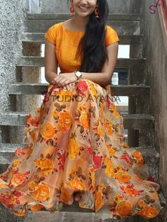 Orange is one of the trending colours, which works really well for Lehenga Choli. Here are 10 best and latest Orange Lehenga Choli Designs which are handpicked especially for this season. Lehenga Choli Designs, Ghagra Choli, Orange Lehenga, Silk Lehenga, Floral Lehenga, Indian Fashion Dresses, Indian Gowns Dresses, Long Gown Dress, Anarkali Dress
