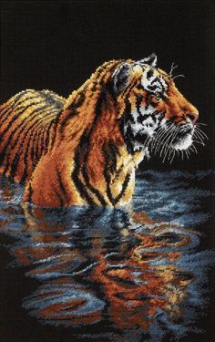 Create a beautiful work of art with this tiger cross stitch kit. This Dimensions cross stitch kit contains everything you need to create a stunning scene featuring a lovely tiger standing in a pool of
