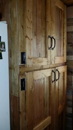 Debbie L Cooney feeling proud of her awesome build.... Repurposing pallet wood at it's best!   You can find her at pallets pallets pallets!! on FB