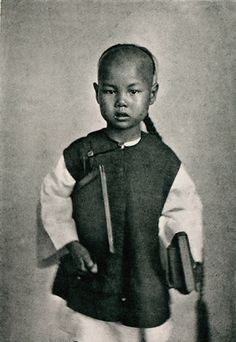 Portrait of a Hong-Kong school-boy was taken by John Thomson and published in 1874.