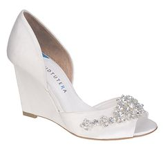 "White David Tutera Winter Bridal Shoes  $165.00 The David Tutera Winter is a gorgeous wedge design perfect for any outdoor event. The simple design featuring a peep toe front and closed d'orsay back let the crystal accents do all the talking. The heel measures 4"" and is available in white satin http://www.bellissimabridalshoes.com/White-David-Tutera-Winter-Bridal-Shoes-Prodview.html"