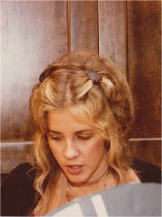 one of Stevie's gorgeous hair styles ~ ☆♥❤♥☆ ~ parted and clipped back on both side with carefully arranged long curls framing her beautiful oval face
