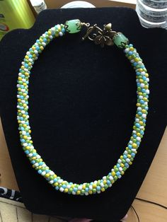 Mixed bead Kumihimo necklace with jade and floral clasp.