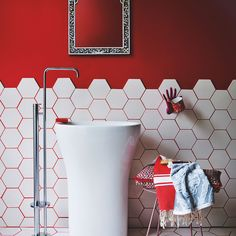 Red bathroom with white hexagon tiles
