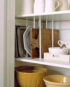 Use tension rods to divide serving trays, platters, and cutting boards.