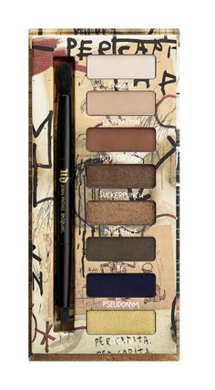 """The new Urban Decay x Jean-Michel Basquiat """"Gold Griot"""" Eyeshadow Palette features some neutrals like beige and taupe and bold colors like navy and gold for the perfect eye look."""