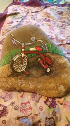 Painted tricycle rock