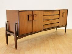 """STUNNING 6ft9 Teak and Walnut, """"Floating"""" External legs by Nathan. Mid Century. on Etsy, $2,100.00"""
