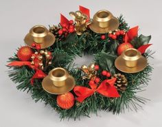 """Berry Advent Wreath by Vermont Christmas. $14.99. Christmas Advent Wreath. Vintage 2010. Candles sold separately.. Find More Advent Calendars, Cards and Puzzles with keyword : sbtadventcalendars. Colorful berries, natural colored pine cones and faux snow make this Advent wreath really stand out. Durable construction measures 11"""". Gift Boxed."""