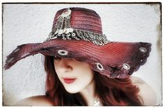 One of a kind Straw Wide brimmed Beach Hat    Hand Painted    Kuchi Chain band    featuring Hand stitching, grommets and    Vintage Kuchi Jewelry and Coins    The word Kuchi itself is derived from a Persian word meaning migration, in relation to nomads or gypsies, and does not describe a particular group or people, but rather a state of being.  These beautiful pieces with colorful glass jewels and jingling bells originally came from the nomadic Pashtoon tribes that wandered the border areas…