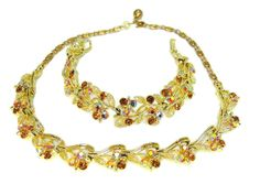 Dazzling AB rhinestones set in a sumptuous gold tone setting.  This vintage…