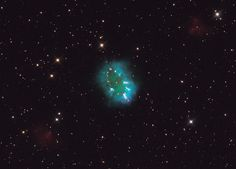 The object, aptly named the Necklace Nebula, is a recently discovered planetary nebula, the glowing remains of an ordinary, Sun-like star. T...