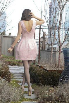 Super cute dress. I love the way it falls in the back.