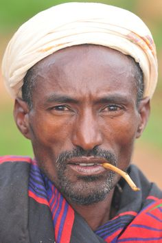 https://flic.kr/p/5BZcTb   Borana man   The Borana live in south Ethiopia and mostly follow their ancient way of living. The gaddaa system is some kind of generation structure, which changes every 7-8 years, the chief of gaddaa is widely respected, even after his gaddaa is finished, he can still keep his regalia: the kalacha (fallus like ornament he is wearing on the forehead), the uroro (stick) and the licha (to whip his wives and whoever needs it according to him). The traditional believe…