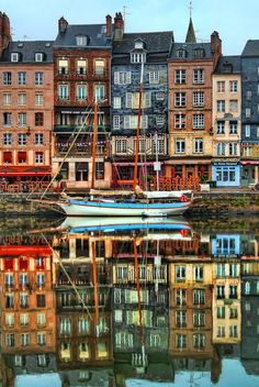 Port de Honfleur, Normandie, France. Beautiful reflections of colorfull houses in still water. #yachts #rentals #happyness