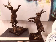 Jolly bronze rabbit bookends.  Makes a beautiful and whimsical addition to your home! www.junedelugasinteriors.com #interiordesign #design #whimsical #bookends