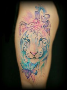 Watercolor style tiger and lily thigh tattoo by Haylo at Lucky Bamboo Tattoo