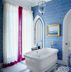For the Vero Beach, Florida, home of philanthropist Jeanne Donner and her family, designer Robert Couturier turned the master bath into a colorful oasis. The Paris bathtub by the Water Monopoly is paired with Waterworks's Etoile fittings, and the glass wall tiles are by Urban Archaeology.