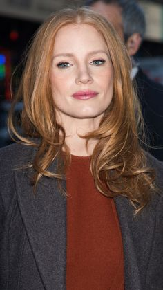 Jessica Chastain's flame-colored hair hangs in loose waves