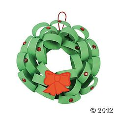 Loopy Wreath Kids' Holiday Craft.  Bet you could do this with a paper plate, cut out center.  Loop green construction paper and glue to paper plate.  Super easy!