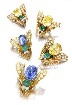 Van Cleef & Arpels. A Set of Bee/Fly Brooches in 18K Gold with a Body of Yellow Sapphires and Emeralds, and Diamond Wings and Eyes. By Van Cleef & Arpels, c. 1940's. Available at FD. www.fd-inspired.com