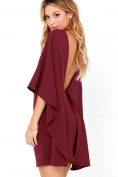 Things are looking up with items like the Best is Yet to Come Burgundy Backless Dress making their way into your wardrobe! A unique, backless silhouette is created by woven poly fabric that drapes into a front tier, and transitions into cape sleeves that trail out at back alongside the sheath skirt. Hidden back zipper.