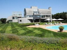 """A modern beachfront property designed by architect Myron Goldfinger, who had one of his homes featured in """"The Wolf Of Wall Street,"""" sold in November 2014 after being listed for $29.5 million."""