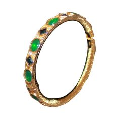Kenneth Jay Lane Vintage Cabochon Emerald & Sapphire Bangle | From a unique collection of vintage bangles at https://www.1stdibs.com/jewelry/bracelets/bangles/