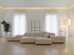 Want to create a cozy and stylish ambiance in your house? Go for indirect lighting and watch the magic. We have eleven great indirect lighting ideas for you Cove Lighting, Indirect Lighting, Interior Minimalista, Living Divani, Living Room, Minimalistic Design, White Leather Sofas, Curtain Lights, Ceiling Lights