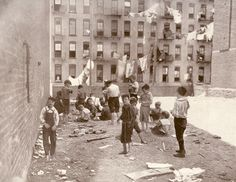 THEIR ONLY SAFE PLAYGROUND- IN THE REAR OF THE TENEMENT.  (East Side, New York-early 1900's)