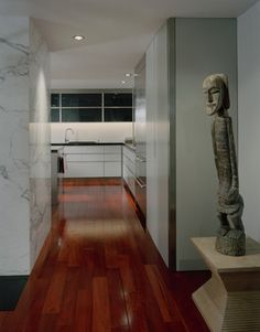 Brazilian Cherry hardwood floors - Pros: beautiful, great color variation, very hard/durable. Cons: they darken when exposed to light (within 6 months), some of those color variations are lost in the process, rugs/furniture protect wood from sunlight and maintain the natural colors - obvious spots if items are moved, darker wood shows more dust/dirt. Still love the look, though. Beautiful.