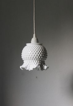 milk glass hobnail ruffled pendant. This is perfect, I inherited a large collection of Fenton hobnail milkglass. I really like the look of this light. I may incorporate rose bowls and light fixtures like this in both the kitchen and bathroom. -CAB