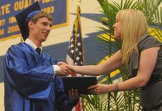 Jacobb Backer receives his diploma during the Waynesboro Area Senior High School Commencement on Tuesday, June, 5, 2012. (Public Opinion/Ryan Blackwell)