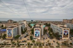 Larger-than-life murals of historical Kazakh political figures adorn apartment buildings in Aqtau, on the shore of the Caspian Sea