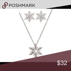 "Beautiful snowflake pendant set beautiful details. Dazzling clear and AB crystals and shimmering pearl beads accent the 1"" silvertone snowflake pendant that dangles from this 16"" adjustable designer-style necklace with matching pierced wire earrings. Jewelry Necklaces"