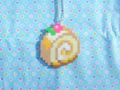 Sweet Cake Roll perler bead Sprite Necklace by DelightfulEpiphany