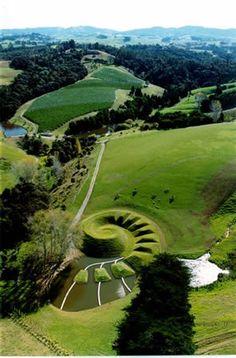 Spiral Earth Sculpture, Koru by Virginia King Brick Bay Sculpture Park, Matakana, North Auckland, 2001  80m diameter across mounds, height rising to 10metres.