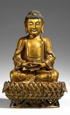 Buddha Shakyamuni in meditation posture on a lotus, and both hands in dhyana mudra on the feet. Ming dynasty, 17th century.