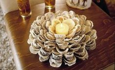 now I just need to find a million Oyster Shells. oyster shell candle holder (DIY directions) - this might look pretty with blue mussel shells too! Oyster Shell Crafts, Oyster Shells, Sea Shells, Beach Cottage Decor, Coastal Decor, Shell Centerpieces, Centerpiece Ideas, Table Decorations, Centrepieces