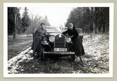 https://flic.kr/p/NX78VQ | Opel 1,8 Liter Cabriolet | Two fashionable ladies in woolen coats posing with an Opel convertible in wintertime. Last remnants of snow can be seen on the side of the road. A white toy hare and a horseshoe have been attached to the radiator as a lucky charms. The car is registered in the formerly Prussian Rhineland (IZ = Rheinprovinz). Ca. 1932.  Country of origin: Germany