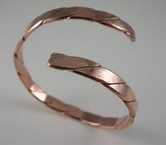 BRACELET SOLID COPPER Heavy 12 Gauge twisted wire 1/4 inch wide Solid Copper Cuff Bracelet. one fits 6 inch and one fits 7 inch wrist by bopartpottery on Etsy