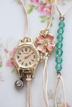 Precious time. vintage watch,enamel dogwood charm,string bracelet set. Tiedupmemories. $18.00, via Etsy.